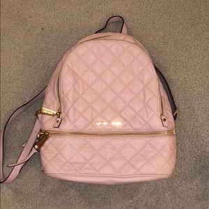 Pink michael kors backpack